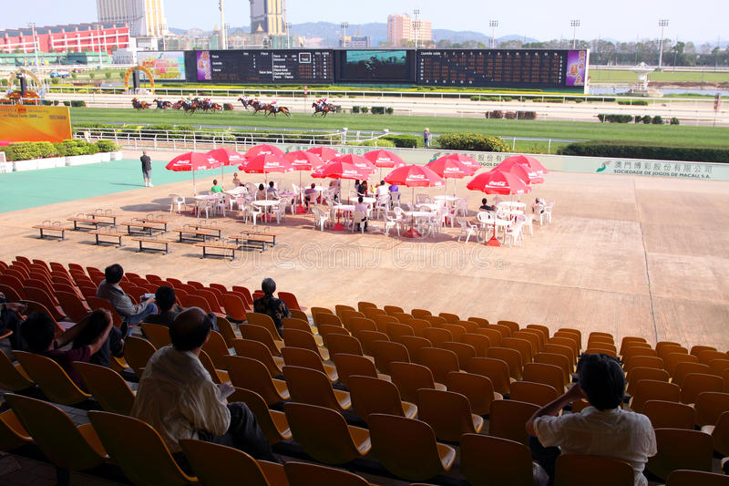 Macau : Taipa Racecourse. Racegoers Watching the Race at the Taipa Racecourse, Macau stock image