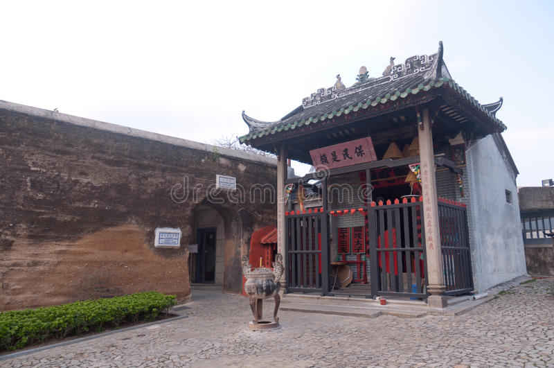 Macau- Taoist temple of Na Tcha. Side by side with the remains of the Portuguese defensive fortification walls. Na Tcha (a child hero in traditional Chinese stock photos