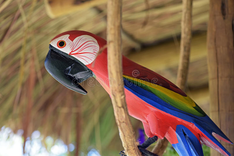Macaw carved in wood, Brazilian craftwork. ITATIBA, SP, BRAZIL - AUGUST 30, 2015 - Macaw carved in wood, craftwork much appreciated in the decoration of country stock photos