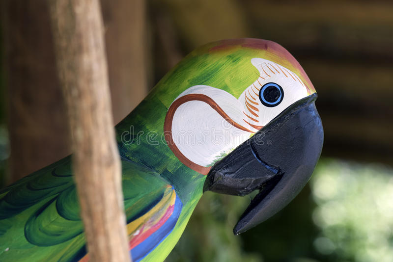 Macaw carved in wood, Brazilian craftwork. ITATIBA, SP, BRAZIL - AUGUST 30, 2015 - Macaw carved in wood, craftwork much appreciated in the decoration of country stock images