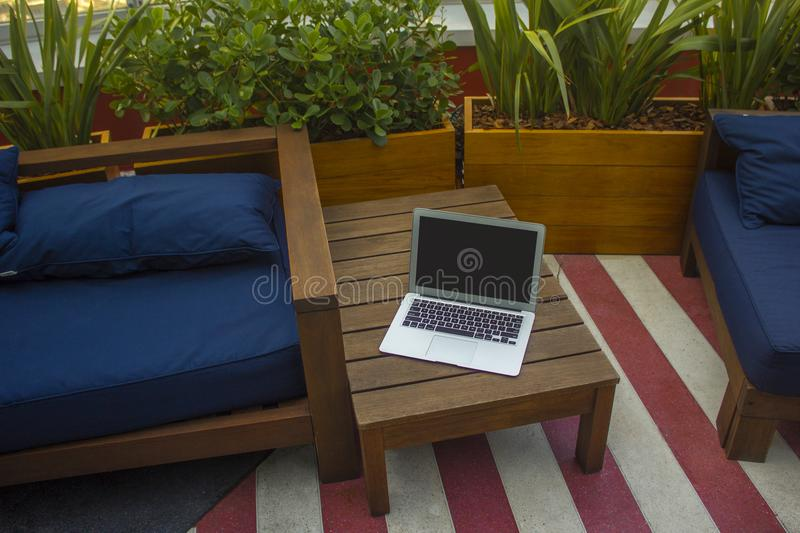Macbook Air On Brown Wooden Table royalty free stock photos