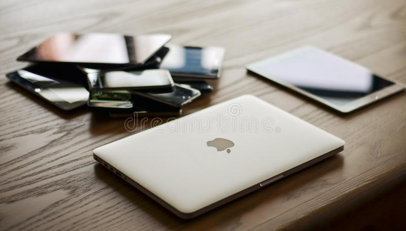 Macbook and Ipad on Desk stock image