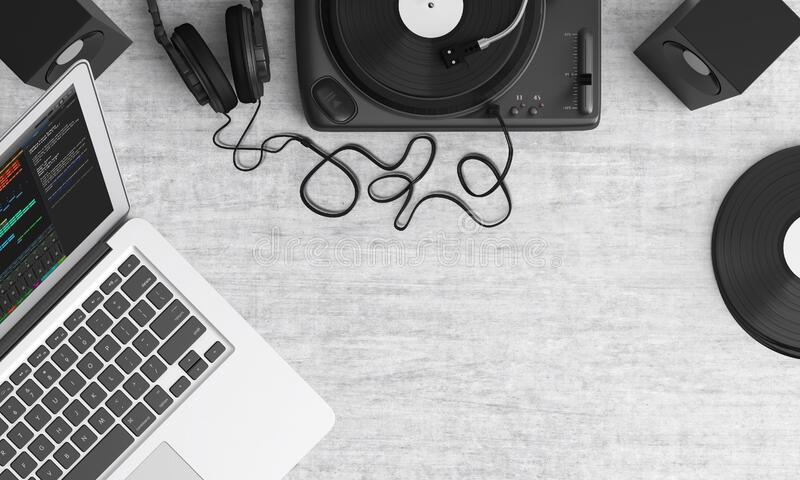 Macbook Pro Beside Black Headphones on Gray Table stock photo