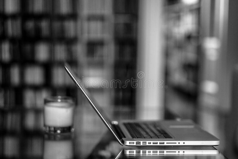 Macbook Pro on Grayscale Photography royalty free stock photos