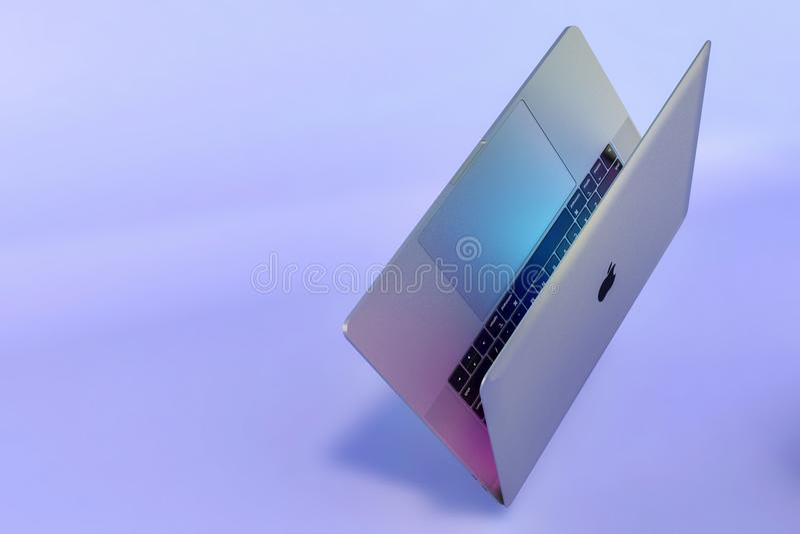 MacBook Pro laptop computer falling scene royalty free stock photo