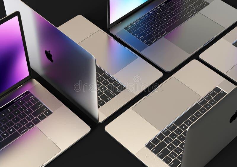 MacBook Pro laptop computers, composition. Laptop computers - Apple MacBook Pro 2018 15 inch, silver, mosaic composition arrangement on a dark background. Dark royalty free stock photos