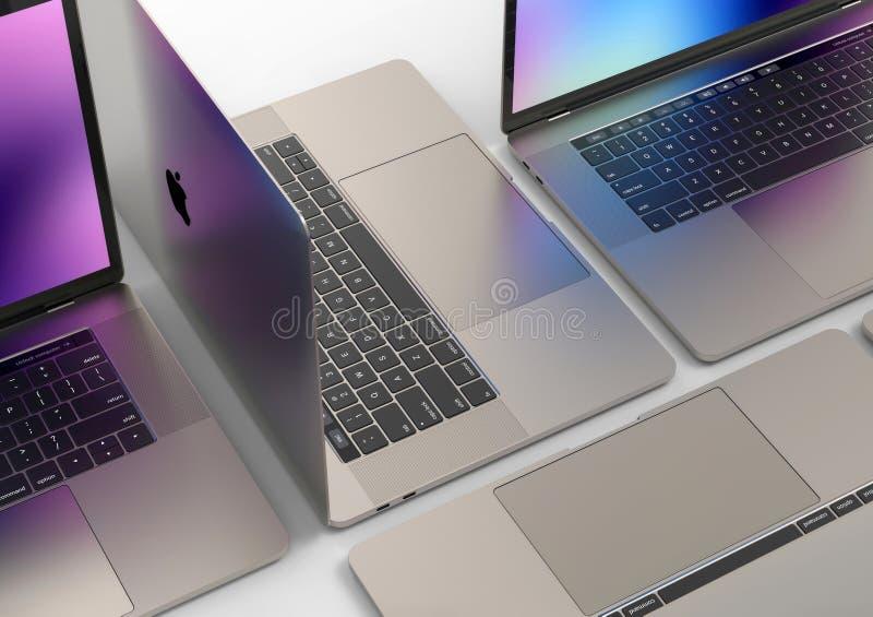MacBook Pro laptop computers, composition. 4 Laptop computers - Apple MacBook Pro 2018 15 inch, silver, mosaic composition arrangement on a dark background. Dark stock image