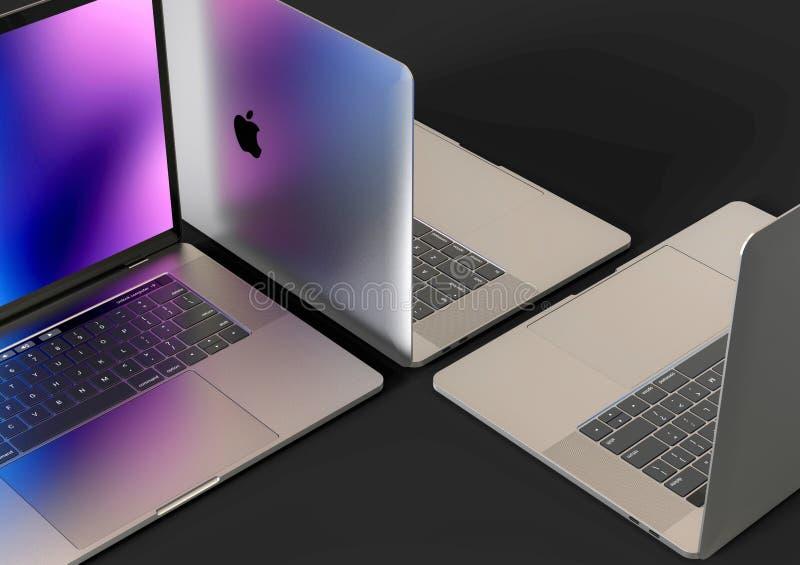 MacBook Pro laptop computers, composition. 4 Laptop computers - Apple MacBook Pro 2018 15 inch, silver, mosaic composition arrangement on a dark background. Dark royalty free stock image