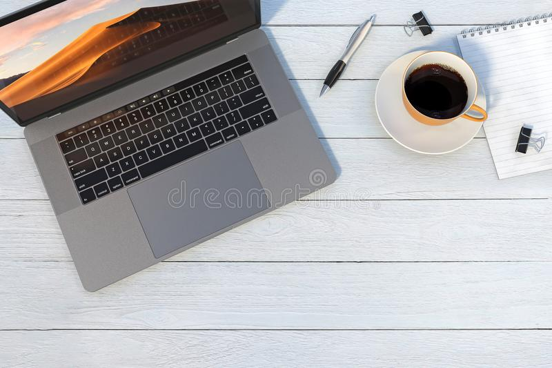MacBook Pro style laptop computer on white desk royalty free stock photos