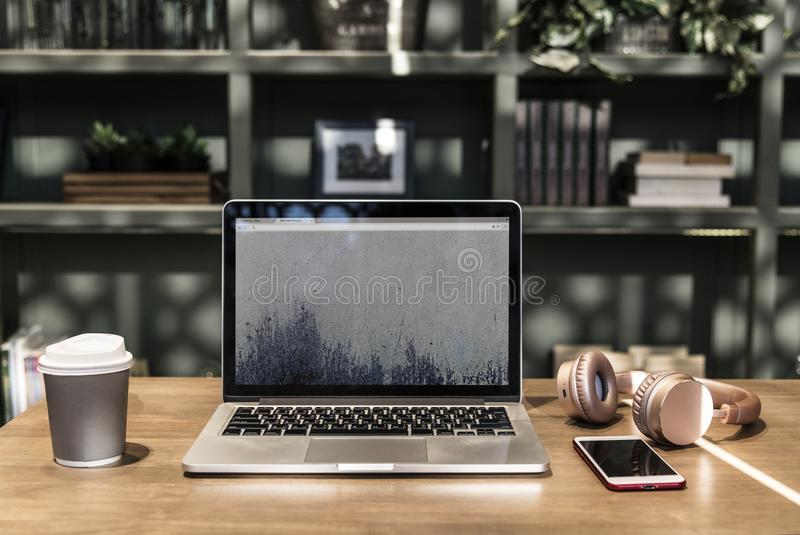 Macbook Pro on Top of Wooden Desk stock images
