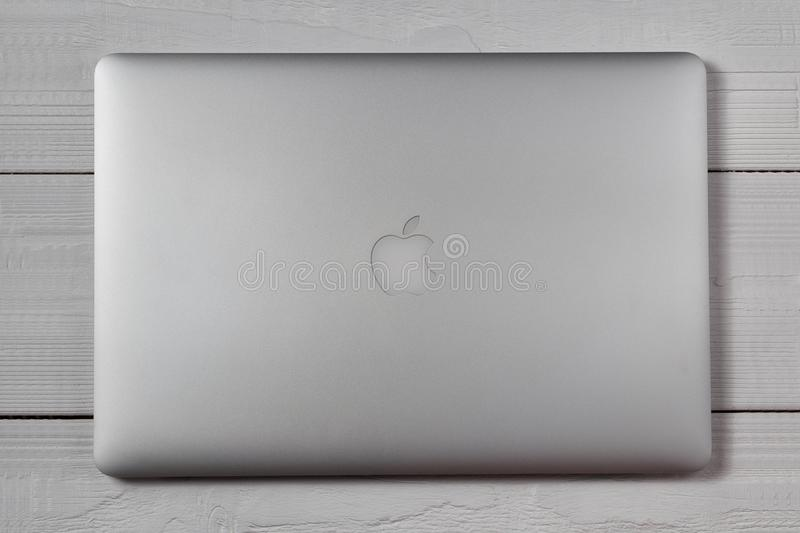 Macbook pro on wooden table. New York, USA - March 27, 2018: Closed silver macbook pro on wooden table top view stock image