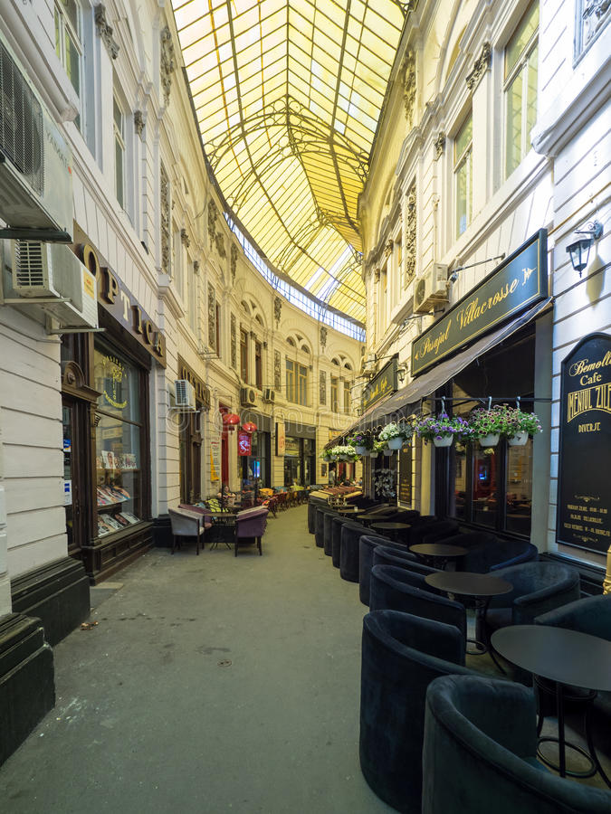 Macca-Villacrosse passage - Bucharest. Macca-Vilacrosse is a fork-shaped, yellow glass covered arcaded street in central Bucharest, Romania royalty free stock photo