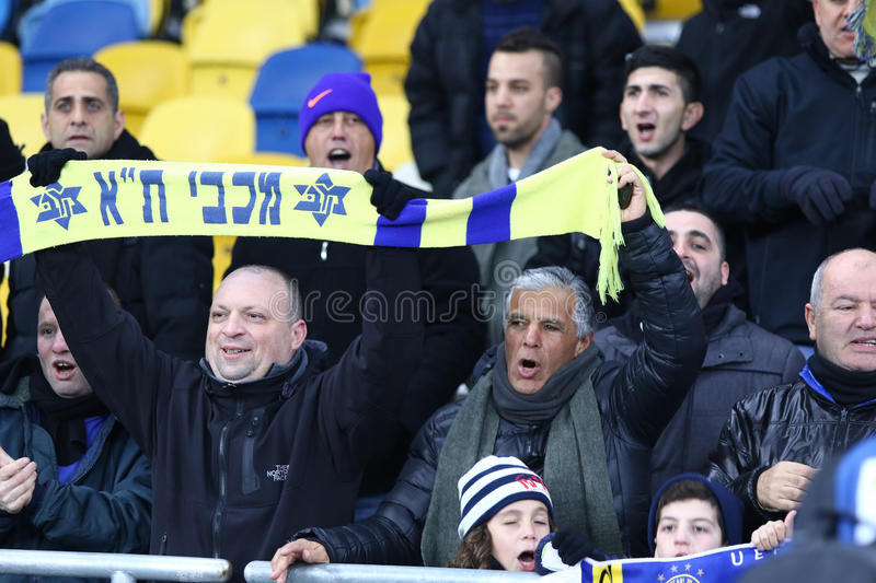 Maccabi Tel-Aviv supporters show their support. KYIV, UKRAINE - DECEMBER 9, 2015: Maccabi Tel-Aviv supporters show their support during UEFA Champions League royalty free stock photos