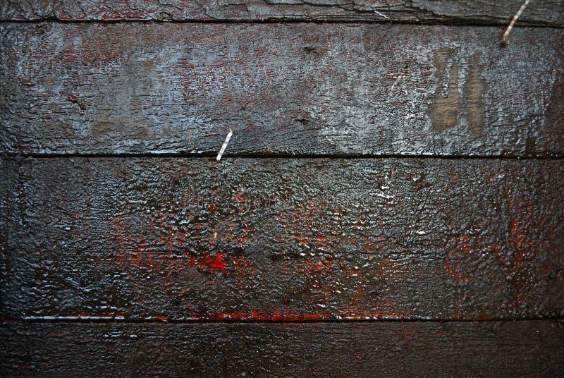 Macchie di olio sul pavimento di legno fotografia stock libera da diritti