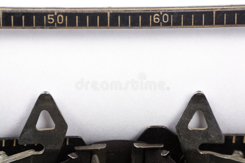 Macchina da scrivere e documento in bianco immagine stock