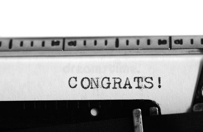 Macchina da scrivere Testo di battitura a macchina: congrats! fotografia stock