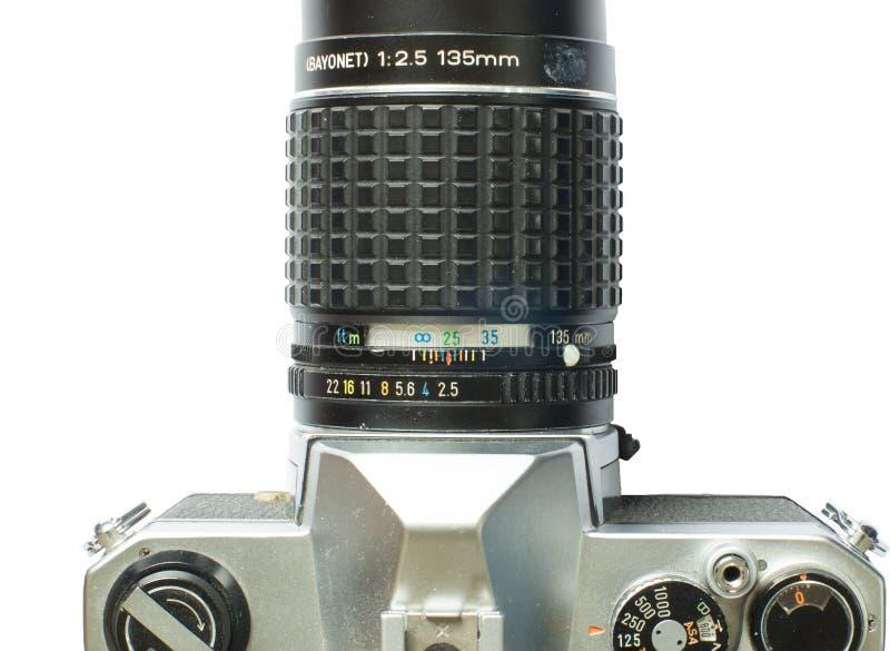 Macchina fotografica d'annata dello slr con il teleobiettivo fotografia stock libera da diritti