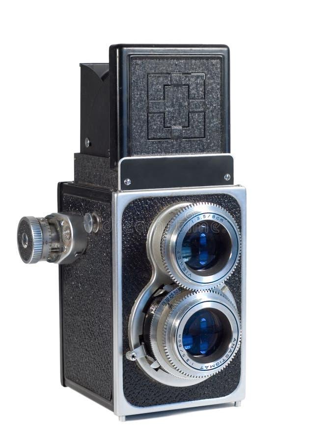 Macchina fotografica degli anni 50 dell'annata isolata su bianco fotografia stock