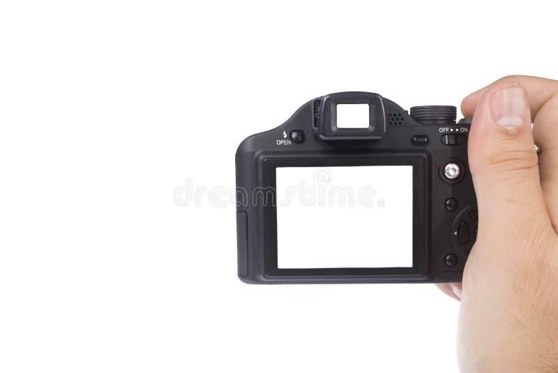 Macchina fotografica della foto della holding della mano fotografie stock