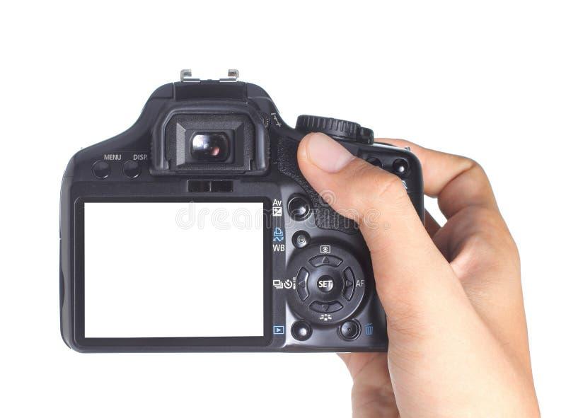 Macchina fotografica della holding della mano fotografie stock