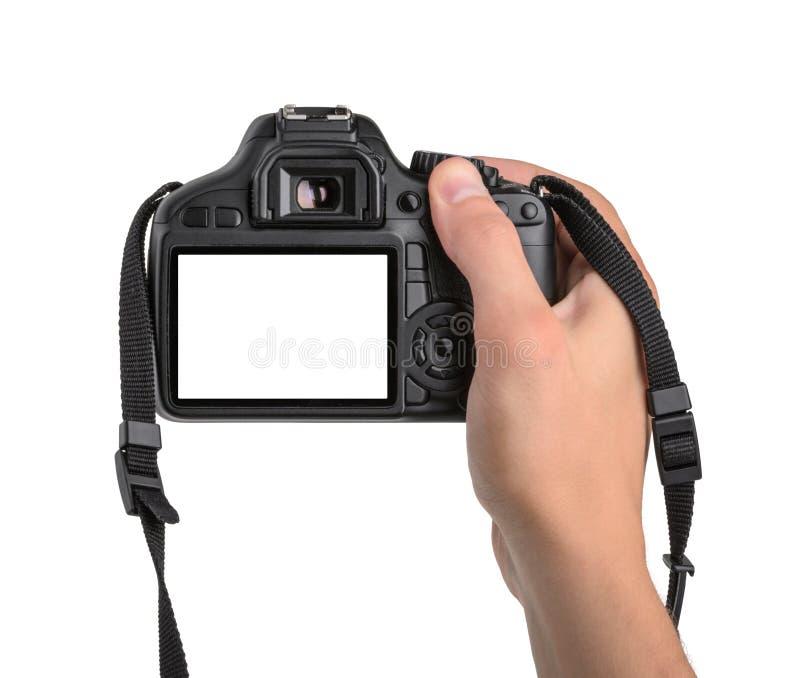 Macchina fotografica di DSLR a disposizione isolata fotografia stock