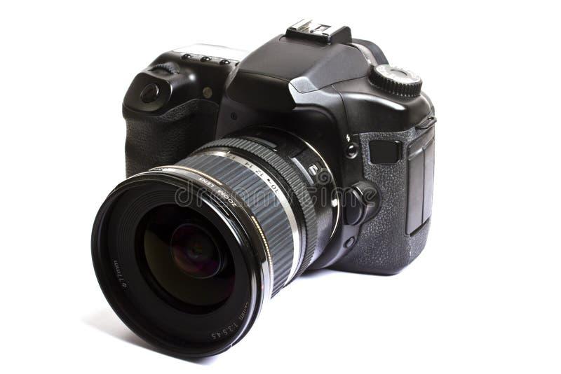 Macchina fotografica di Dslr isolata su bianco fotografia stock