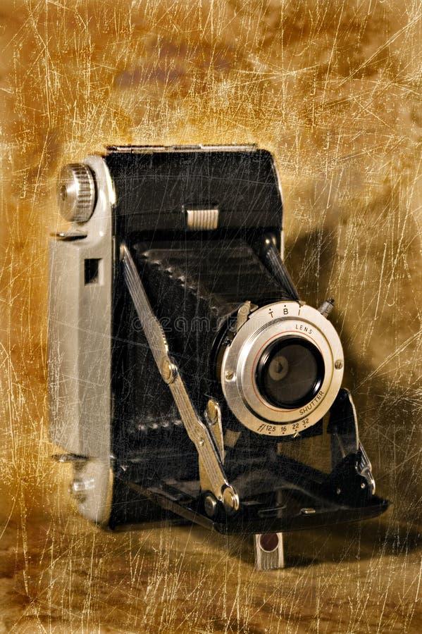 Macchina fotografica di piegatura antica con struttura di Grunge fotografia stock