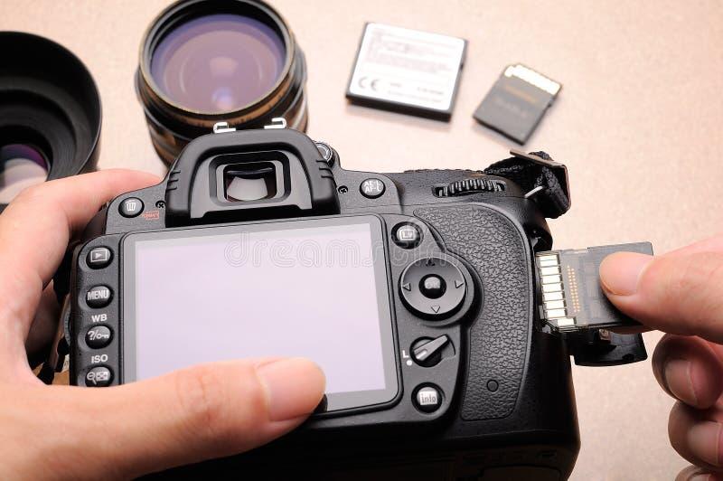 Macchina fotografica e scheda di memoria immagine stock