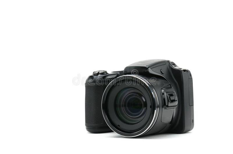 Macchina fotografica isolata su priorità bassa bianca fotografie stock