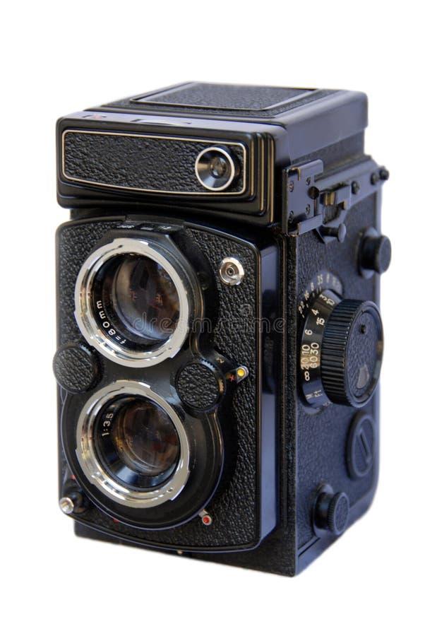 Macchina fotografica reflex dell'obiettivo gemellare su bianco immagini stock