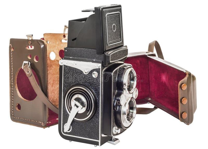 Macchina fotografica reflex della lente gemellata dell'annata con l'intelaiatura distaccata del cuoio di Brown isolata su fondo b fotografie stock