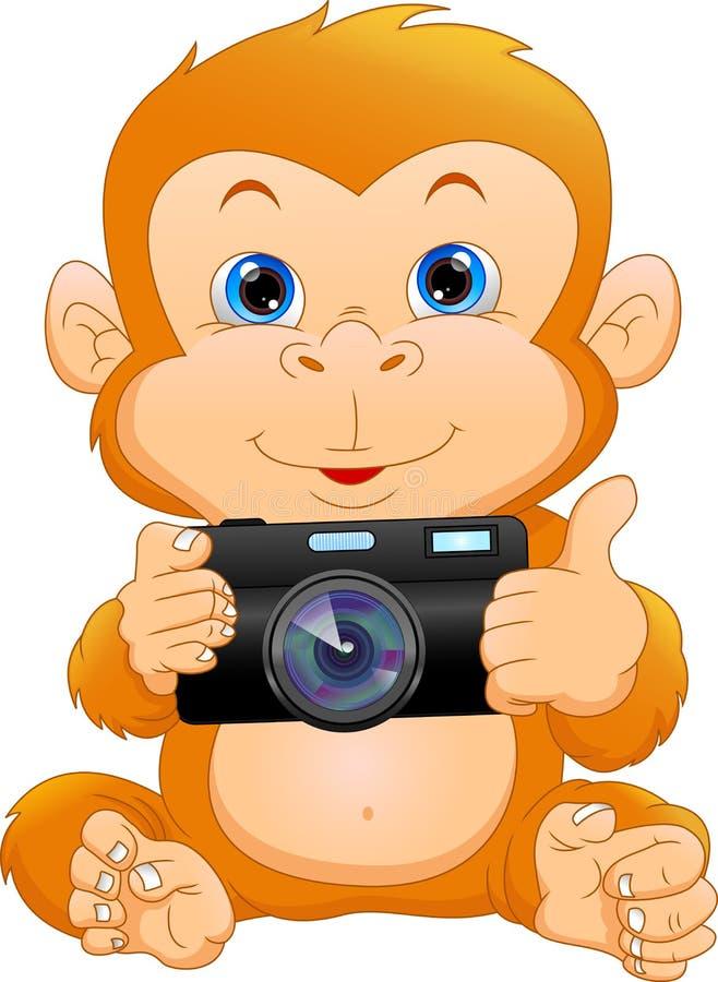 Macchina fotografica sveglia della tenuta del fumetto della scimmia illustrazione di stock
