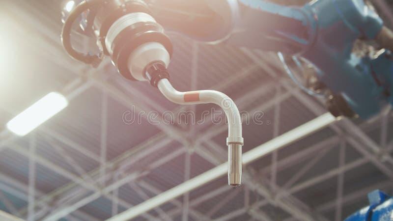 Macchina robot automatizzata per saldatura industriale, tonificata fotografia stock libera da diritti