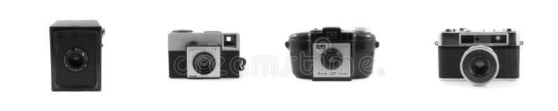 Macchine fotografiche d'annata isolate su bianco fotografie stock