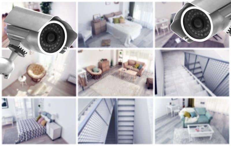 Macchine fotografiche moderne del CCTV con la vista vaga delle posizioni domestiche fotografia stock libera da diritti