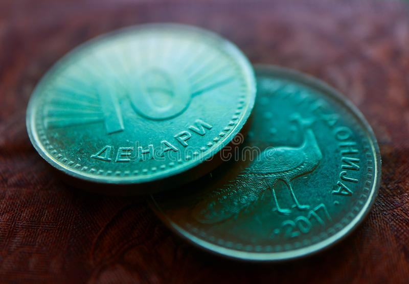 Macedonia currency denar on the banknote pattern background, close up. Photo depicts Macedonian cash shiny denari metal coins, cl. Ose up, macro view royalty free stock photos