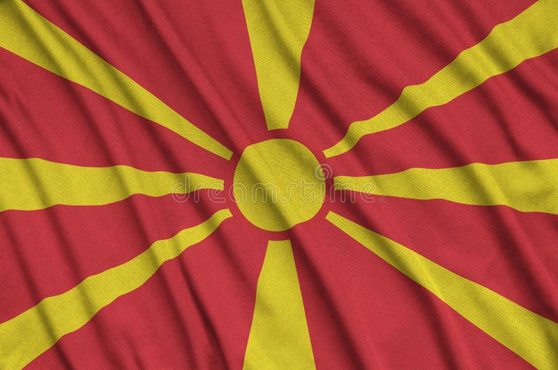 Macedonia flag is depicted on a sports cloth fabric with many folds. Sport team banner royalty free stock image