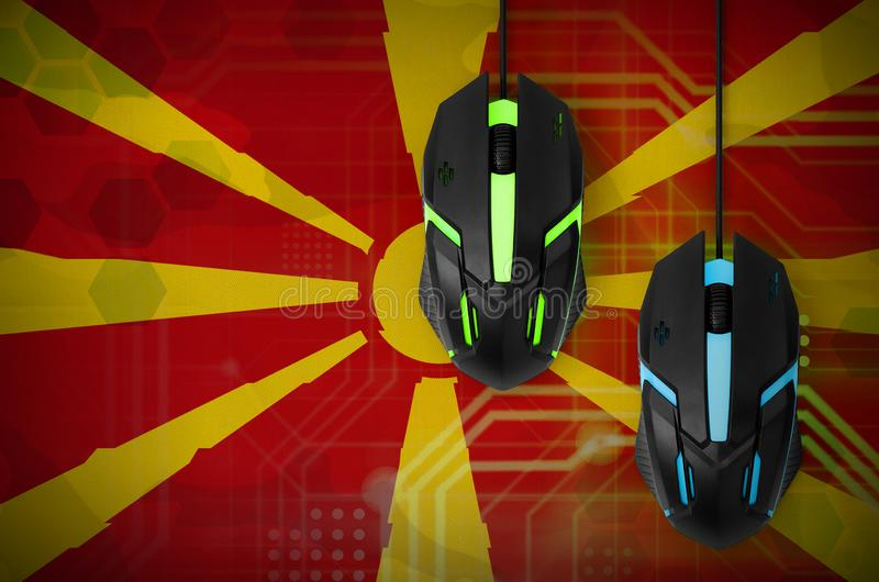 Macedonia flag and two mice with backlight. Online cooperative games. Cyber sport team stock photography