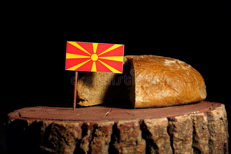 Macedonian flag on a stump with bread royalty free stock photos