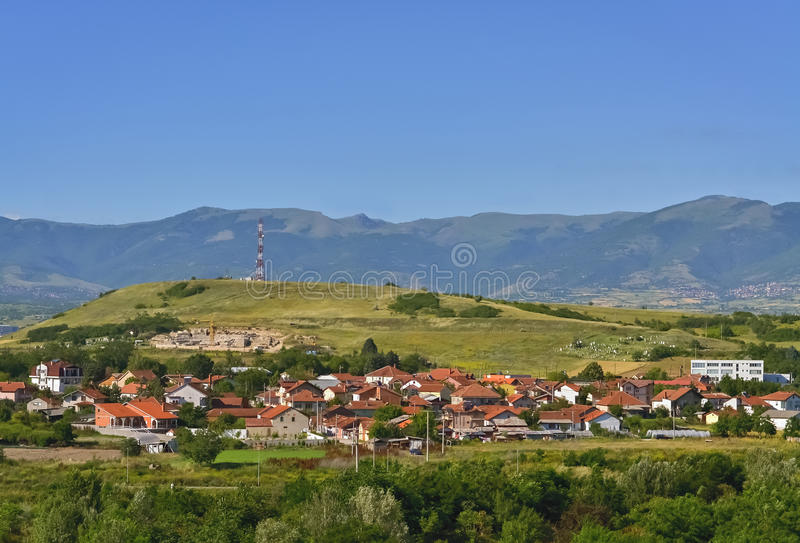 Macedonian village and small hill stock images