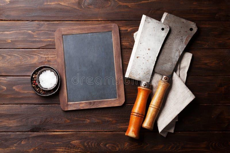 macellaio Coltelli d'annata e spezie della carne immagine stock