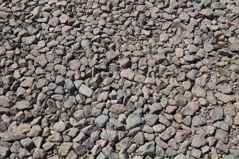 Macerie di pietra per uso come fondo o struttura con una macchia del cemento fotografia stock libera da diritti