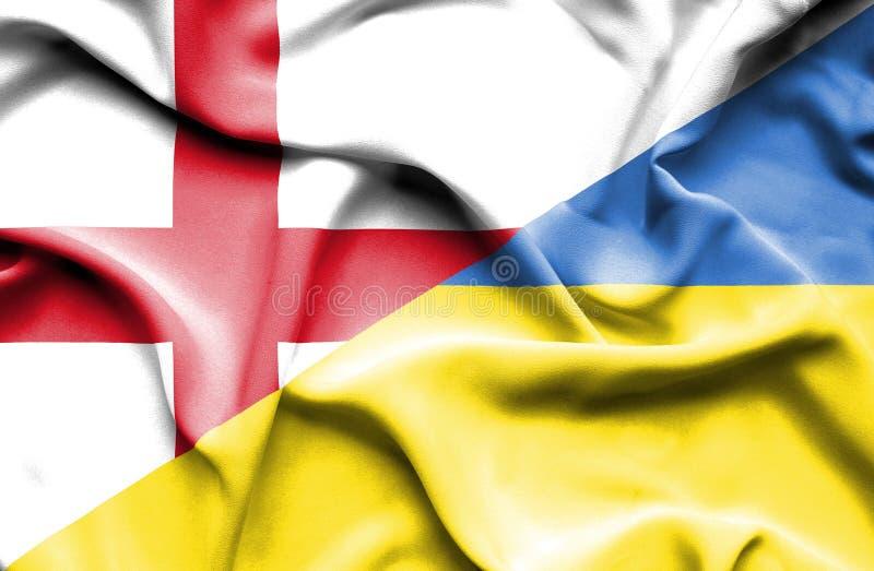 Machać flagę Ukraina i Anglia zdjęcie royalty free