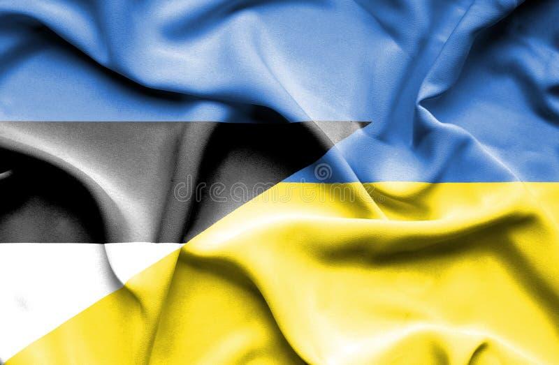 Machać flagę Ukraina i Estonia obrazy stock