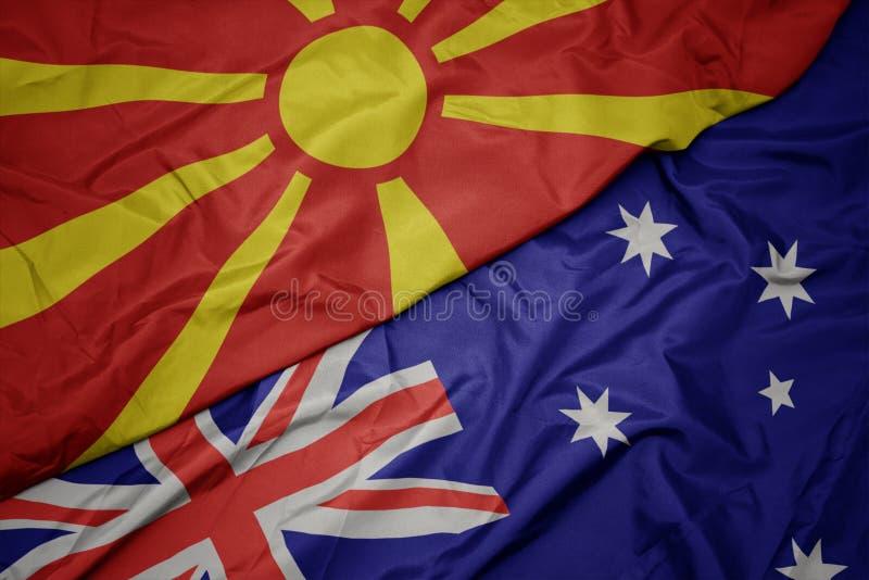 machać kolorową flagę Australia i flagę państowową Macedonia zdjęcie stock