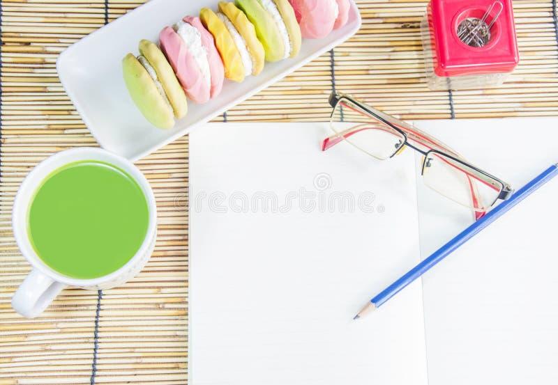 Macha green tea and macaroon snack royalty free stock image