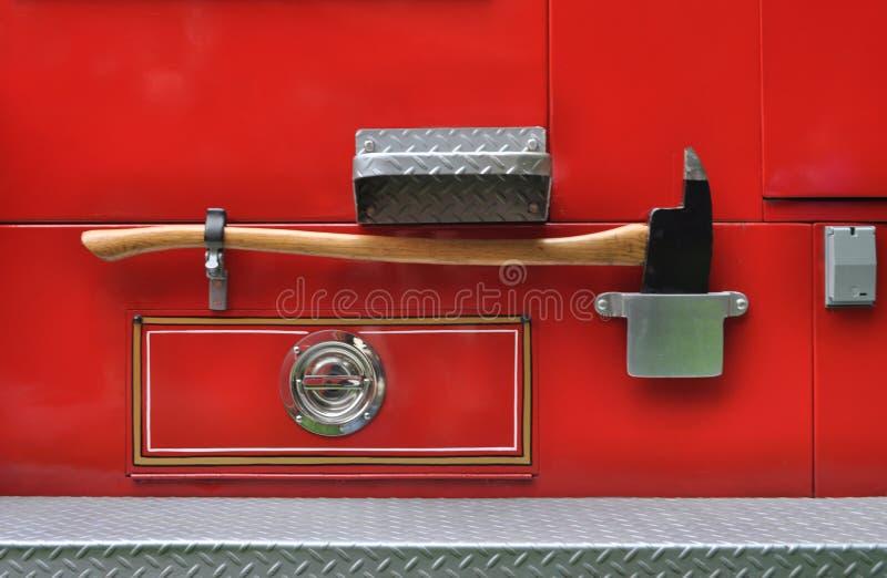 Machado em um carro de bombeiros imagens de stock royalty free