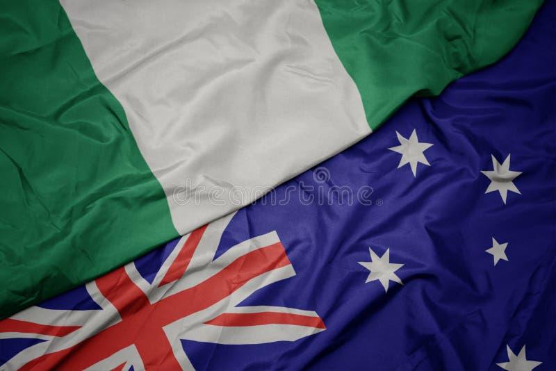 machajÄ…ca kolorowÄ… banderÄ… Australii i narodowej bandery Nigerii obraz stock