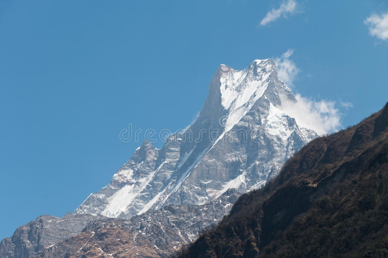Machapuchare is a mountain in the Annapurna Himalayas stock images