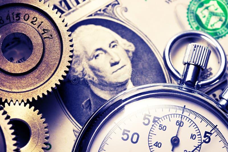 Machinalny stopniowo zmieniać, stopwatch i dolar zdjęcia royalty free